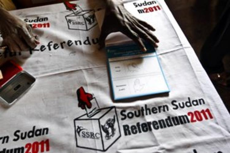 An electoral official holds a block of ballot papers during voting preparations in Khartoum on Jan. 9, 2011. (Khaled Deskouki/Getty Images)