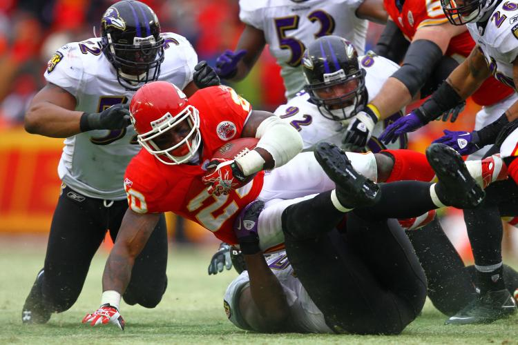 Running back Thomas Jones #20 of the Kansas City Chiefs is tackled by the Baltimore Ravens during their 2011 AFC wild card playoff game at Arrowhead Stadium on January 9, 2011 in Kansas City, Missouri. (Dilip Vishwanat/Getty Images)