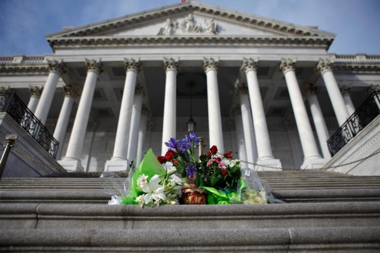 Flowers left by well-wishers are stack on the center steps of the U.S. Capitol to honor the victims of Saturday's mass shooting in Arizona January 10, 2011 in Washington, DC.  (Chip Somodevilla/Getty Images)