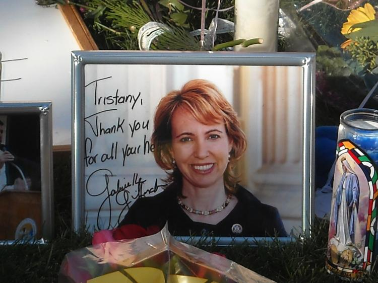 Portrait of Congresswoman Gabrielle Giffords at a makeshift memorial outside the hospital in Tucson, Arizona where she is in critical condition on January 10, 2011. On Tuesday Doctors said that she is now able to draw breath on her own.   (Shaun Tandon/Getty Images )