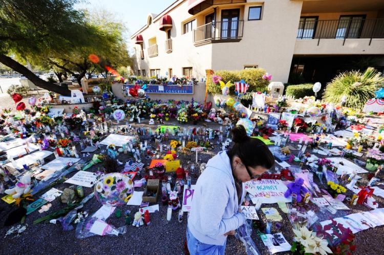 Barb Tuttle is overcome with emotion at a makeshift memorial outside the office of Rep. Gabrielle Giffords (D-AZ) on January 12, 2011 in Tucson, Arizona. (Kevork Djansezian/Getty Images)