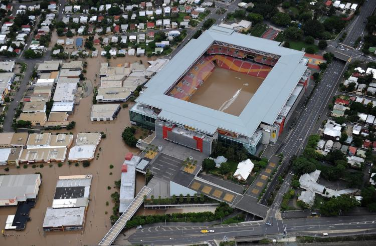 Aerial photograph of the iconic Suncorp Stadium (C) filled with the murky flood waters of the Brisbane River as flood waters devastate much of Brisbane on January 13, 2011. Australia's third-largest city awoke to a 'war zone' with whole suburbs under water and infrastructure smashed as the worst flood in decades caused wide destruction.  (Torsten Blackwood/Getty Images)