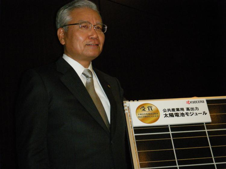 Japan's high-tech giant Kyocera president Tetsuo Kuba displays the company's latest solar power cell at a press conference in Toko on Jan. 21, 2011. (Karyn Poupee/AFP/Getty Images)