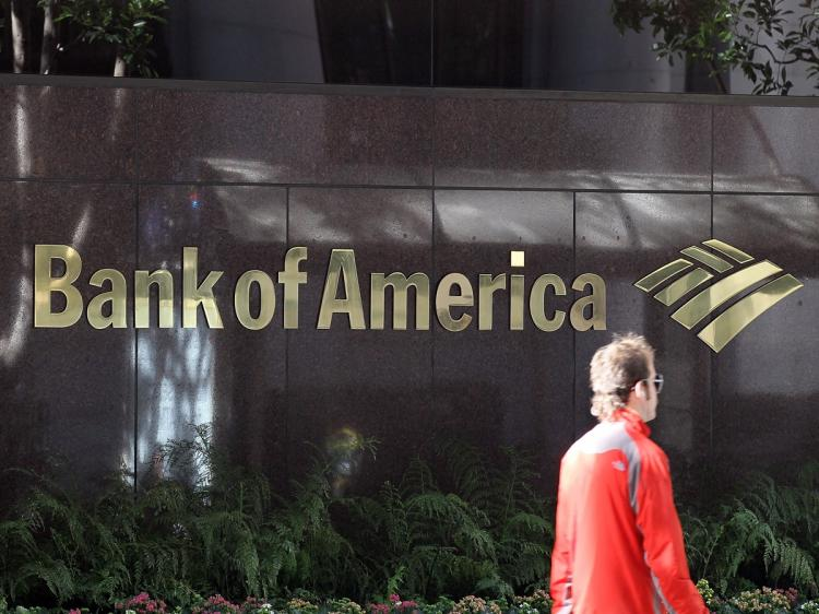 POSSIBLE COLLUSION: A pedestrian walks by a Bank of America branch office this past January in San Francisco, California. Bank of America was one of four of the world's largest banks which were served subpoenas for possible colluding over LIBOR rates be (Justin Sullivan/Getty Images)
