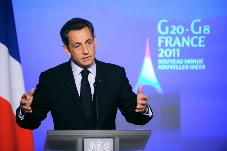 NEW IMAGE: French President Nicolas Sarkozy speaks during a press conference at the presidential Elysee palace Jan. 24 in Paris. (Eric Feferberg/GETTY IMAGES)