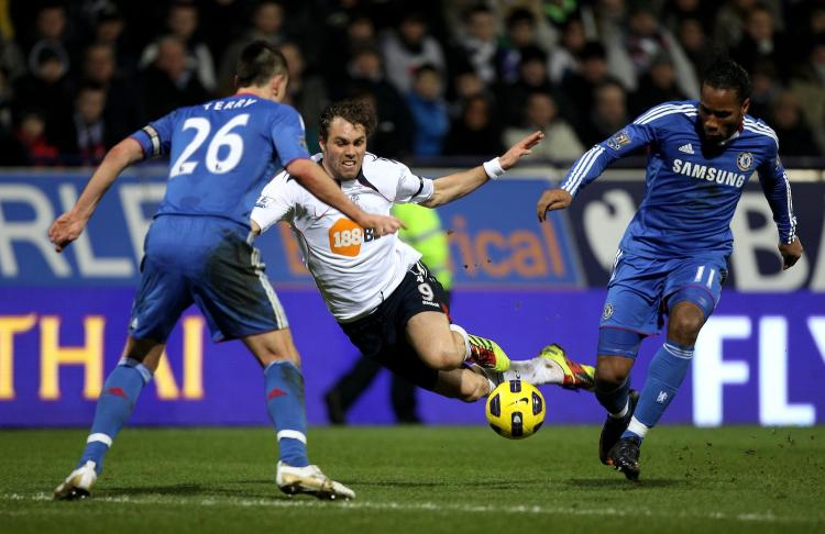 Johan Elmander of Bolton Wanderers tangles with Didier Drogba of Chelsea during the Barclays Premier League match between Bolton Wanderers and Chelsea at the Reebok Stadium on January 24, 2011 in Bolton, England.   (Michael Steele/Getty Images )