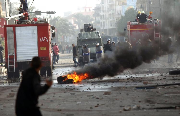 A burning tire and rocks litter the streets as Egyptians protesters clash with anti-riot police on the streets of Suez, northern Egypt, on January 27 2011, demanding the ouster of President Hosni Mubarak. (Khaled Desouki/AFP/Getty Images)