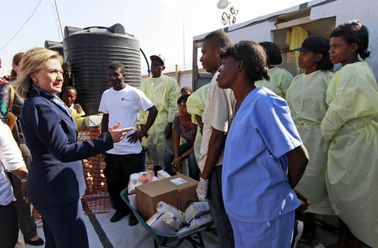 Hillary Clinton talks with workers as she visits Partners in Health Cholera Treatment Center in Port-au-Prince on January 30, 2011.  (Alex Brandon/AFP/Getty Images)