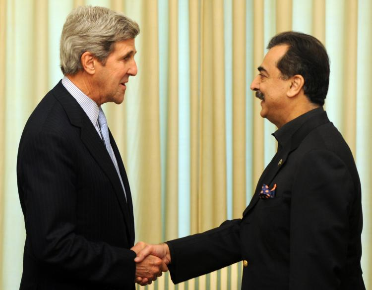 John Kerry (L) shakes hands with Pakistan's Prime Minister Yousuf Raza Gilani prior to a meeting at The Prime Minister House in Islamabad on Feb. 16. (Aamir Qureshi/AFP/Getty Images)