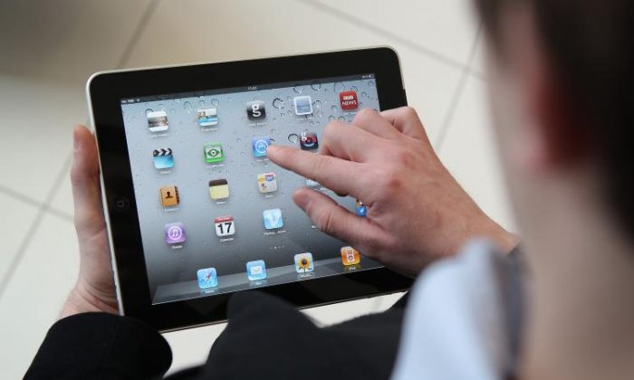 A man uses an Apple iPad tablet. (Peter Macdiarmid/Getty Images)