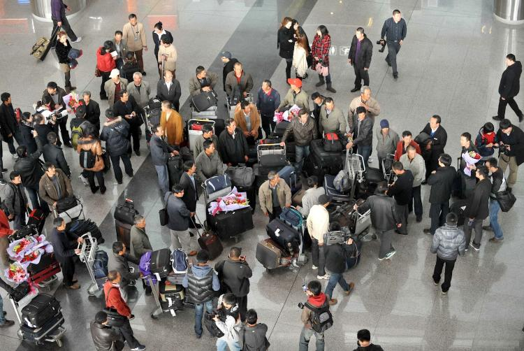 A group of Chinese citizens who were evacuated by Chinese government from Libya arrive at the Beijing Capital Airport in Beijing on Feburary 24, 2011.  (STR/Getty Images)