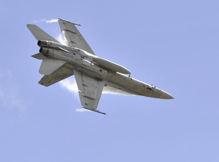 Pictured above, a Royal Australian Air Force F-18 performs. On April 6, 2011, a Navy F-18 crashed in central California, killing two. (Paul Crock/AFP/Getty Images)