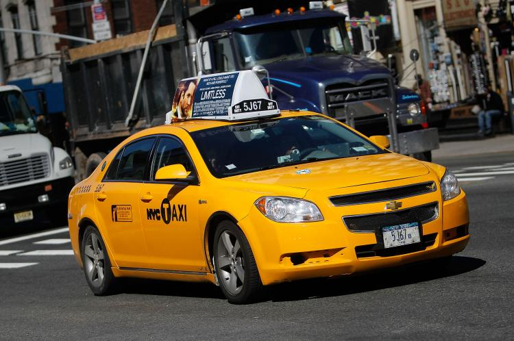 NEW YORK, NY - MARCH 01: A taxi cab drives on a street March 1, 2011 in New York City. (Chris Hondros/Getty Images)