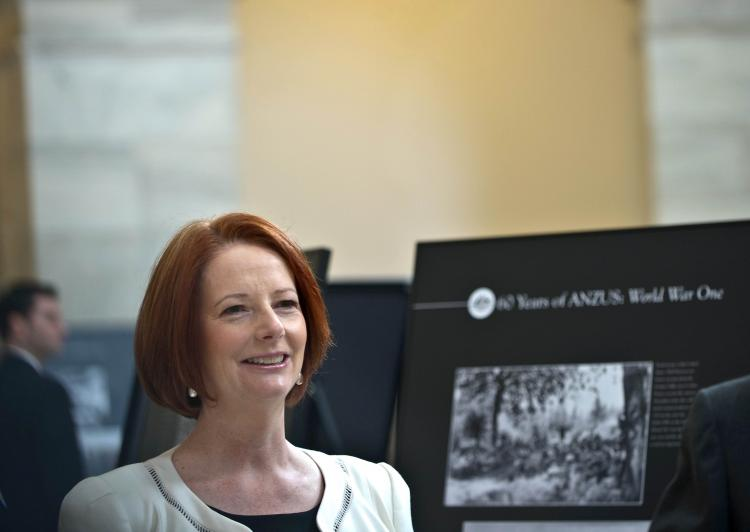 Australian Prime Minister Julia Gillard tours a photo exhibition in Washington. 'The United States and China are both important to our future,' she told US reporters. (Nicholas Kamm/AFP/Getty Images)