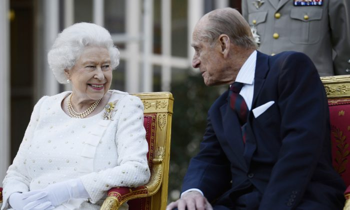Queen Elizabeth II and Prince Philip, Duke of Edinburgh, attend a garden party in Paris, hosted by Sir Peter Ricketts, Britain's ambassador to France ahead of marking the 70th anniversary of the D-Day landings during World War II in Paris, France, on June 5, 2014. (Owen Humphreys/Getty Images)
