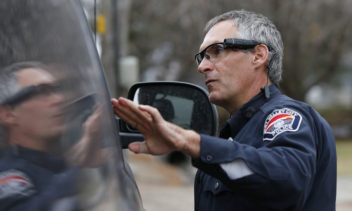 West Valley City patrol officer Gatrell performs a traffic stop on the first day of use of his newly-issued body camera attached to the side of a pair of glasses on March 2, 2015 in West Valley City, Utah. (George Frey/Getty Images)