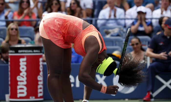 Serena Williams reacts after losing a point to Roberta Vinci, of Italy, during a semifinal match at the U.S. Open tennis tournament, Friday, Sept. 11, 2015, in New York. (AP Photo/Julio Cortez)