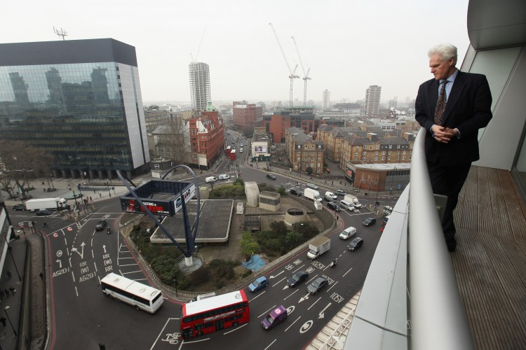 SILICON ROUNDABOUT: A man looks out over the Old Street roundabout in Shoreditch, London, on March 15. The area has been dubbed 'Silicon Roundabout' due to the concentration of technology companies operating there. (Oli Scarff/Getty Images)