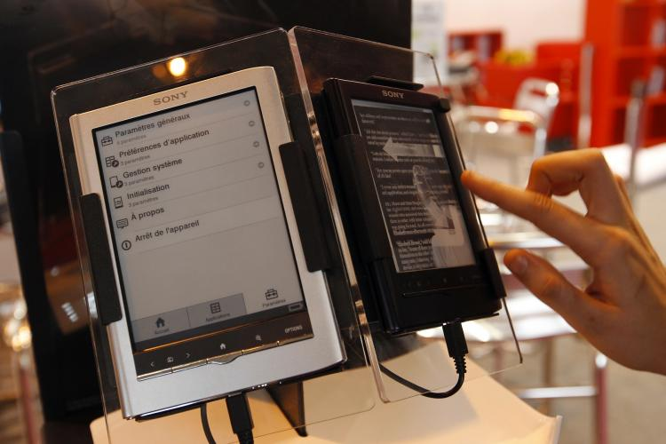 E-BOOKS: A person tests an e-book reader during the 31st Paris book fair on March 18 in Paris. E-books sales have now exceeded paperbacks in the U.S.
