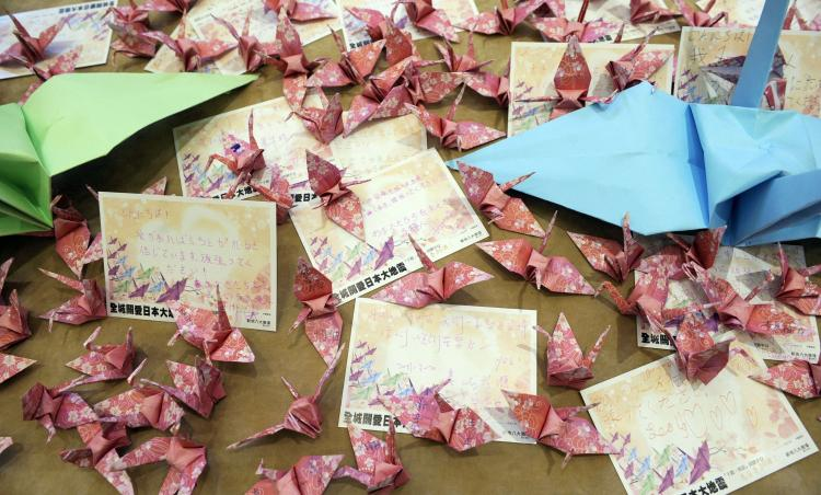Good luck messages and origami cranes, part of 5,000 that were to be folded, lie on a table during a donation drive for victims of the Japan earthquake and tsunami, at a shopping plaza in Hong Kong. According to Japanese tradition, folding 1,000 cranes will bring good luck and a wish will be granted. (Antony Dickson/AFP/Getty Images)