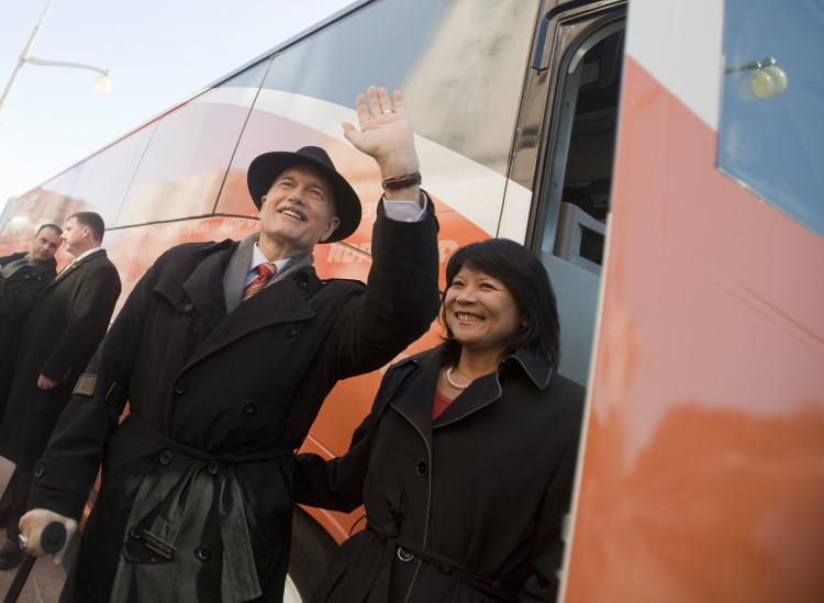 New Democratic Party leader Jack Layton waves to the crowd as he boards the bus with his wife, NDP Member of Parliament Olivia Chow, following the NDP's campaign kickoff event at the Chateau Laurier in Ottawa on March 26. (Geoff Robins/AFP/Getty Images)