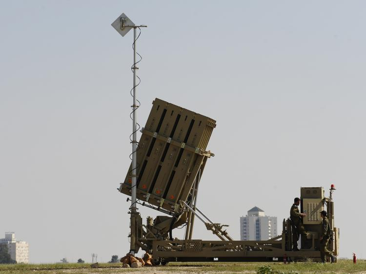 Israeli soldiers stand next to a launcher, part of the first 'Iron Dome' missile defence system deployed in Israel, near the southern city of Beer Sheva on march 27, 2011.  (David Buimovitch/Getty Images)