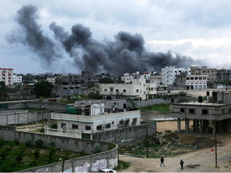 Smoke billows from a mosque following an Israeli air raid December 31, 2008, in Gaza City. Hamas uses mosques for storing and making missiles.  (Abid Katib/Getty Images)