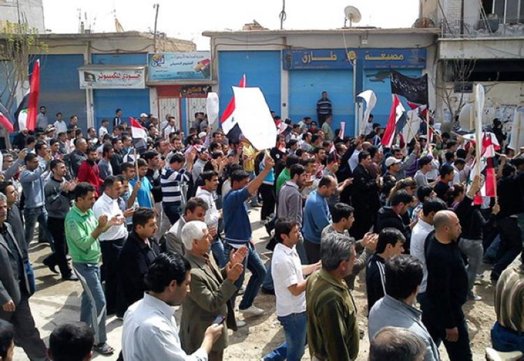 Syrian anti-government protesters march in the northeastern town of Qamishli on April 1, 2011 as hundreds of Syrians emerged from Friday prayers to protest in the first rallies since President Bashar al-Assad dashed hopes for greater freedoms. (AFP/Getty Images)