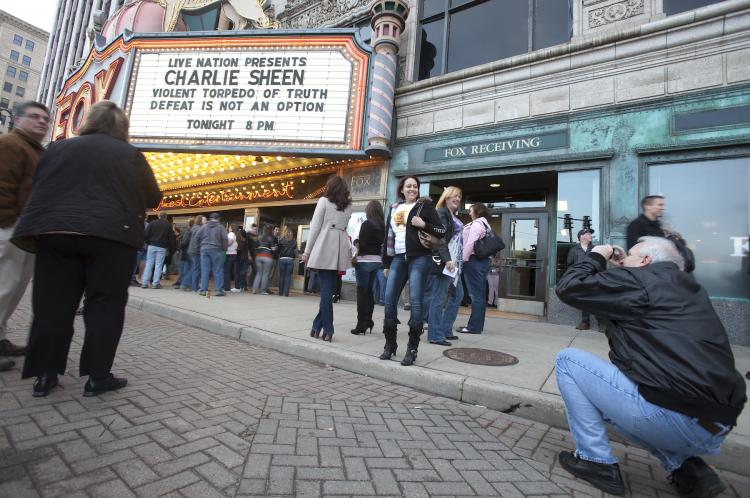 Charlie Sheen fans pose for pictures in front of the Fox Theatre in Detroit, Michigan on April 2, to start his show 'Violent Torpedo of Truth/Defeat is Not an Option,' which which saw Sheen walk off the stage during his performance.   (Geoff Robins/Getty Images )