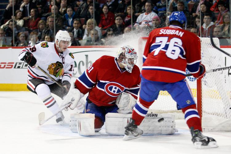Carey Price (C) and P.K. Subban played key roles in confirming Montreal's entry into the NHL playoffs on Tuesday night against Chicago. (Richard Wolowicz/Getty Images)