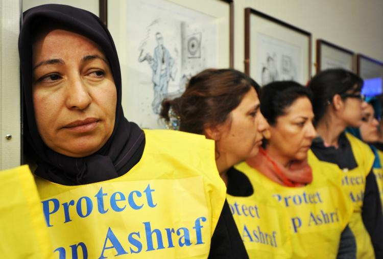 Relatives of residents of Camp Ashraf in Iraq mourn during a press conference in Washington, DC, on April 8, 2011. (Jewel Samad/AFP/Getty Images)