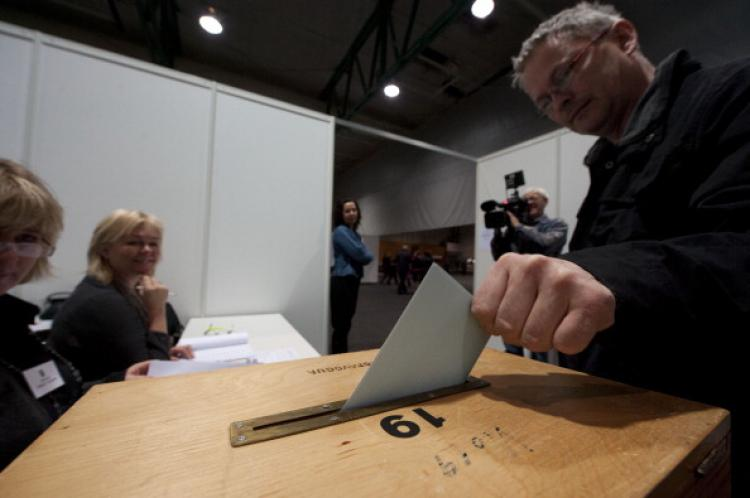 A man votes at a polling station at Smarinn in Kopavogur on April 9, 2011. About 230,000 Icelandic voters went to the polls Saturday to approve or reject a renegotiated deal to compensate the U.K. and the Netherlands over the 2008 collapse of Icesave bank (Halldor Kolbeins/AFP/Getty Images)