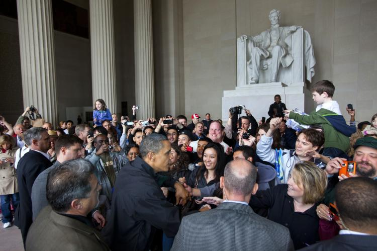 SIGH OF RELIEF: President Barack Obama shakes the hands of tourists visiting the Lincoln Memorial during a surprise visit a day after budget negotiations with Congress prevented a government shutdown April 9.  (Jim Lo Scalzo-Pool/Getty Images)