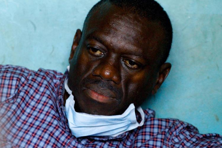 Ugandan opposition leader Kizza Besigye at the Kasangati police station after being arrested close to his house on April 11.  (Marc Hofer/Getty Images)