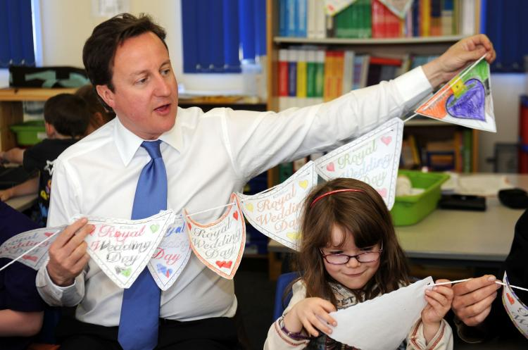 David Cameron makes royal wedding bunting with pupils at the English Martyrs RC Primary School in Manchester, north-west England, on April 11, 2011. He has urged the public to go ahead with royal wedding street parties. (Owen Humphrey/AFP/Getty Images)