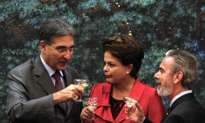 Brazilian President Dilma Rousseff (C) toasts with Brazil officials after a signing ceremony with Chinese officials at the Great Hall of the People in Beijing on April 12. (NG Han Guan/AFP/Getty Images)