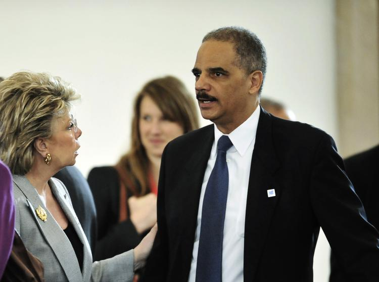 US Attorney General Eric Holder (R) prior to a joint meeting of the representatives of EU and US for justice and home affairs, in the Grasssalkovich Royal Palace in Godollo on April 14, 2011. (Attila Kisbenedek/AFP/Getty Images)