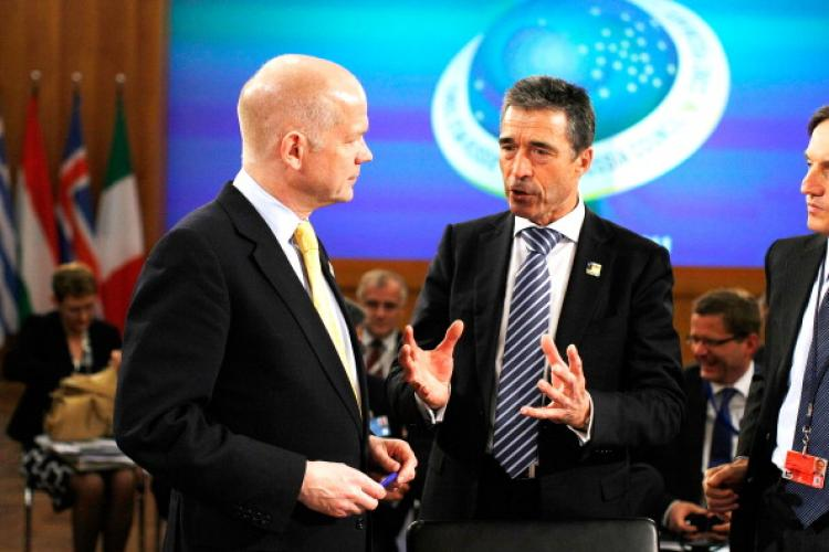 NATO Secretary General Anders Fogh Rasmussen (R) talks with U.K. Foreign Secretary William Hague (L) at an informal meeting of NATO member foreign ministers on April 15, 2011 in Berlin, Germany.  (Carsten Koall/Getty Images)