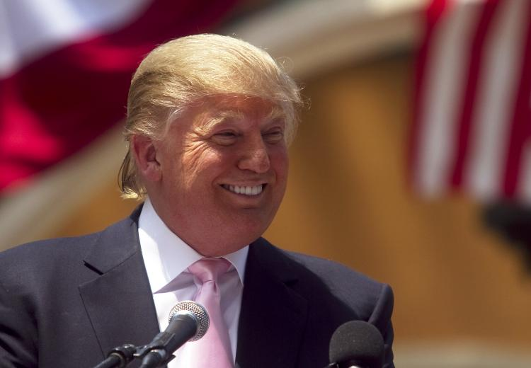 PRESIDENT TRUMP? Billionaire Donald Trump laughs while speaking to a crowd at the 2011 Palm Beach County Tax Day Tea Party on April 16 at Sanborn Square in Boca Raton, Fla. Trump is considering a bid for the 2012 presidency and is expected to announce his running in the coming weeks. (John W. Adkisson/Getty Images)