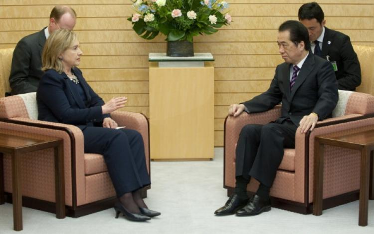 Japanese Prime Minister Naoto Kan sits alongside US Secretary of State Hillary Clinton during meetings at the Kantei in Tokyo, April 17, 2011.  (Saul Loeb/AFP/Getty Images)