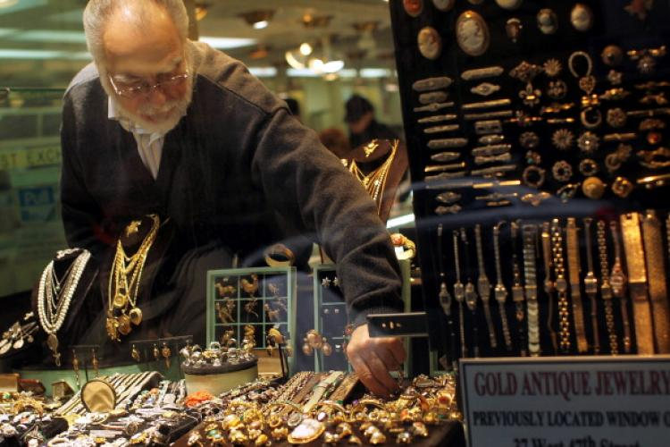 A gold jeweler reaches for a display piece in the window on April 19, 2011 in New York City. Gold futures climbed to a record $1,500 level today following a weaker dollar and higher oil prices. Gold settled at a record $1,494.50 per troy ounce on the Come (Spencer Platt/Getty Images)