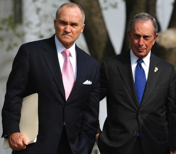 NEW YORK IN WASHINGTON: Mayor Michael Bloomberg (R) stands with NYPD Commissioner Raymond Kelly (L) after a meeting with President Barack Obama on immigration reform on April 19.  (Mandel Ngan/Getty Images )
