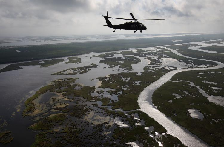 A Louisiana National Guard blackhawk flies over marshland on April 19. A year after the BP oil spill, BP claims that most of the oil has been removed. Louisiana Wildlife and Fisheries says, however, that much of the cleaning has been superficial, as the oil has seeped into the soil, killing marshes and further eroding the state's damaged delta ecosystem. (John Moore/Getty Images)