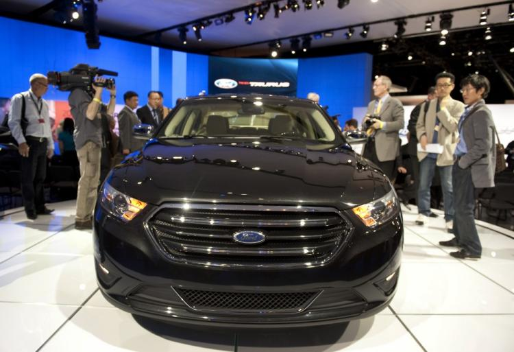 Media get a close look at a Ford Taurus April 20, 2011 during the New York Auto show in New York.Auto makers from around the world gathered to introduce their latest models.  (Don Emmert/AFP/Getty Images)
