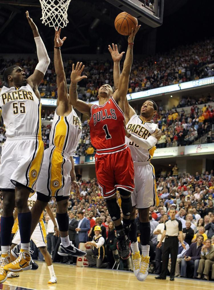 UNTOUCHABLE: Derrick Rose made the game-winning layup on Thursday night in the face of three Indiana players in Game 3.