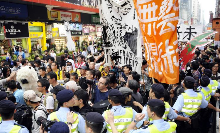 Artists protest during a march to demand the release of detained prominent Chinese artist Ai Weiwei in Hong Kong on April 23. Armed with banners, posters, masks and various musical instruments, over 1,000 protesters walked across the city's downtown district of Tsim Sha Tsui. Ai Weiwei remains missing after being intercepted by government officials in Beijing on April 3.  (Laurent Fievet/Getty Images)