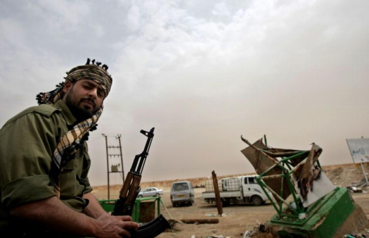A Libyan rebel guards a post at the battle front of the strategic town of Ajdabiya on April 25, 2011.  (Marwan Naamani/AFP/Getty Images)