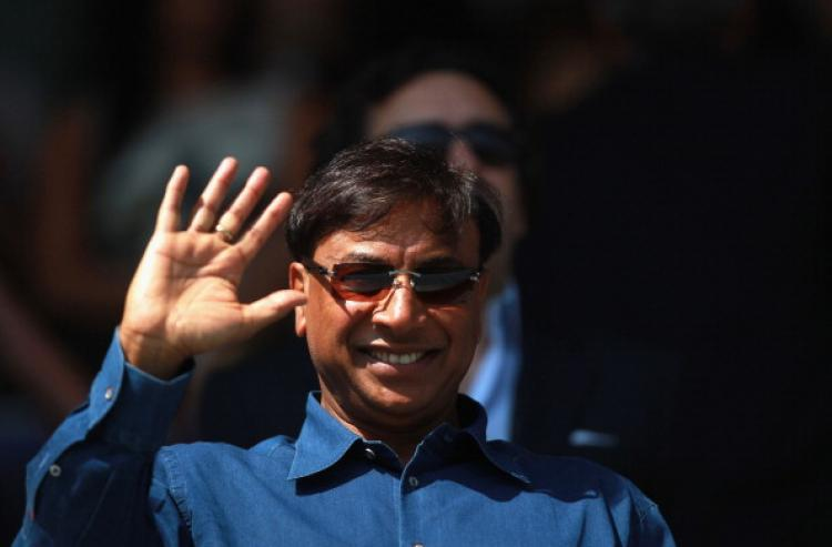 Lakshmi Mittal, Britaian's richest man and owner of Queens Park Rangers Football Club (QPR), waves before the npower Championship home match at Loftus Road in London between QPR and Hull City on April 25. (Warren Little/Getty Images)