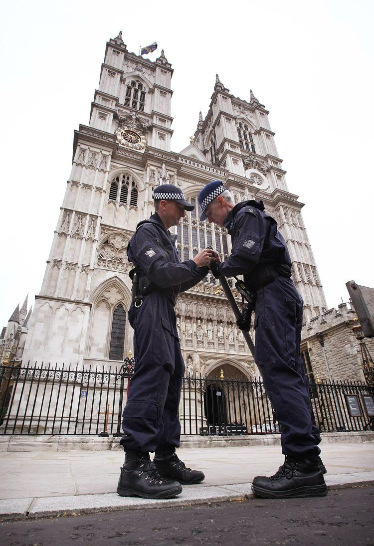 Police check a scaffolding bar outside Westminster Abbey on April 26 in London. With only two full days to go before the royal wedding security checks and last-minute preparations are continuing around Westminster Abbey, Buckingham Palace, and on the route the couple will take. (Peter Macdiarmid/Getty Images)