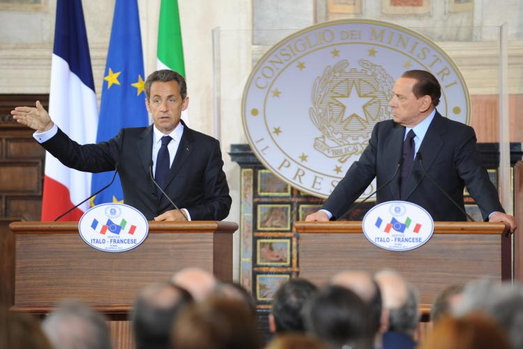 French President Nicolas Sarkozy (L) and Italian Prime Minister Silvio Berlusconi hold during a joint press conference at the end of an Italy and France summit on April 26, 2011 at Villa Madama in Rome. (Andreas Solaro/AFP/Getty Images)